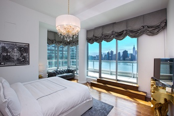 Spectacular Penthouse Along the Waterfront with 3 Beds/3 Baths, Wrap Around Terrace, and Gorgeous Views